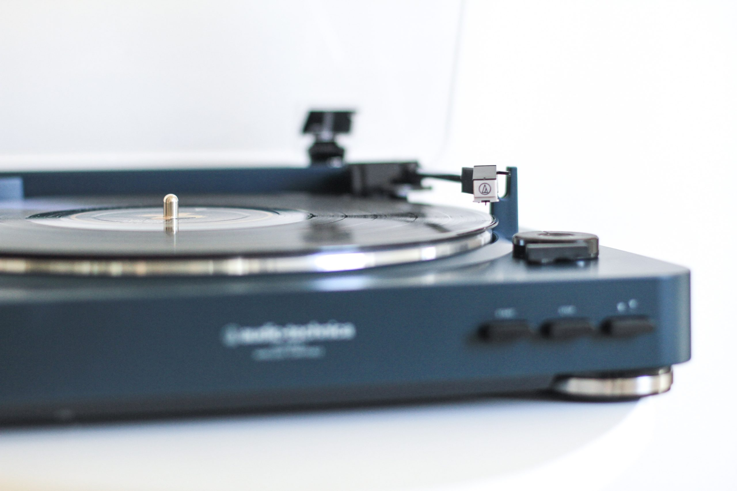 selective focus photography of turntable
